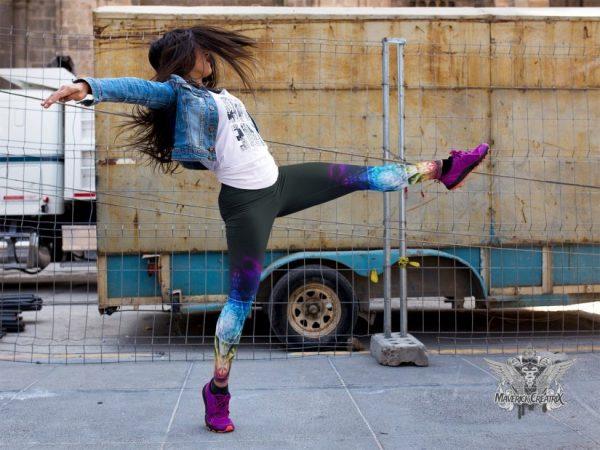 girl-dancing-on-the-street-while-wearing-leggings-rainbow flower of life