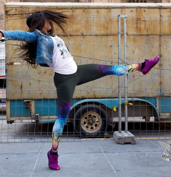 girl-dancing-on-the-street-while-wearing-leggings-rainbow flower of life